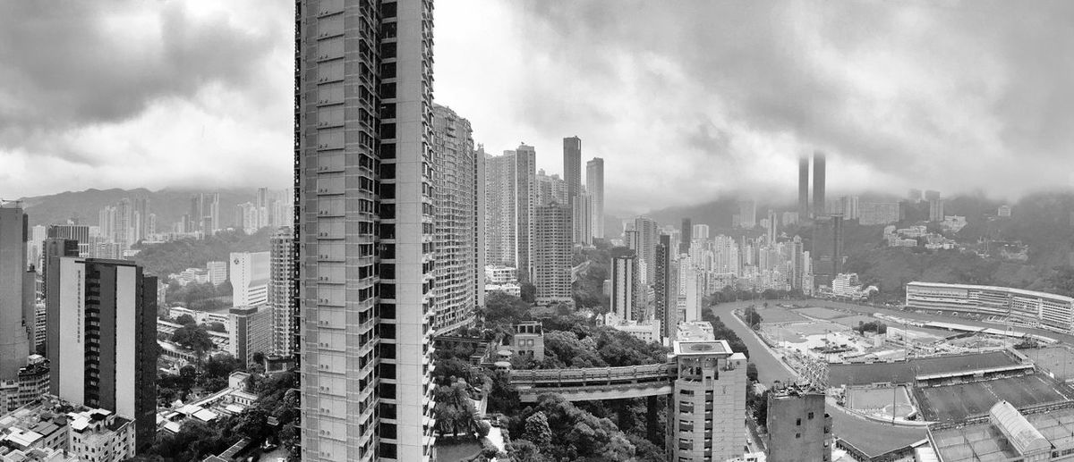 Happy Valley Racecourse Hong Kong Architecture ASIA Black And White Building Exterior Built Structure City Cityscape Cloud - Sky Clouds And Sky Day Happy Valley Racecourse Hippodrome De Caen Hong Kong Hong Kong Jockey Club Modern Mountain Nature No People Outdoors Racecourse Sha Tin Sky Skyscraper Wong Nai Chung Rd