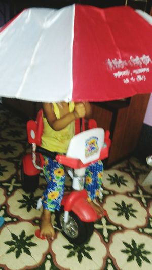 Tricycle Riding With Umbrella On