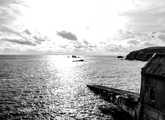 Slide slowly into the light and beyond Sky Sparkling Water Lifeboat Station... Sea And Sky Monochrome Black And White Rocks And Water Cornwall Beauty In Everything For My Friends That Connect AMPt_community No People Cornwall Uk Seascape Beauty In Nature Summertime EyeEm Nature Lover Ocean Water Nature Sea View Ladyphotographerofthemonth Architecture Eyeem Photo Lost In The Landscape