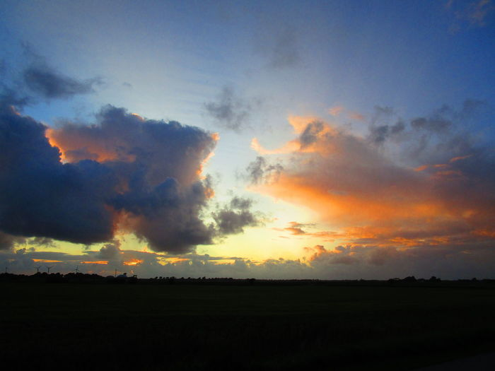 feine wolkenlandschaft am abend im Koog vor der stadt....... Nature On Your Doorstep WOW Adore Beauty In Nature Cloud - Sky Environment Field Horizon Horizon Over Land Idyllic Land Landscape My Universe Nature Nature_collection No People Non-urban Scene Orange Color Outdoors Scenics - Nature Silhouette Sky Sunset Tranquil Scene Tranquility