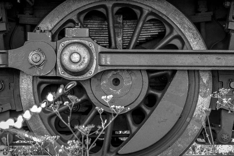 Metal Gear No People Close-up Chain Wheel Outdoors Day Clock Roman Numeral Clock Face Minute Hand Locomotive Locomotiv Workshop Train Train Station Andernach Germany Oldtimer Blackandwhite Old Train Monochrome Backgrounds Mysterious Transportation
