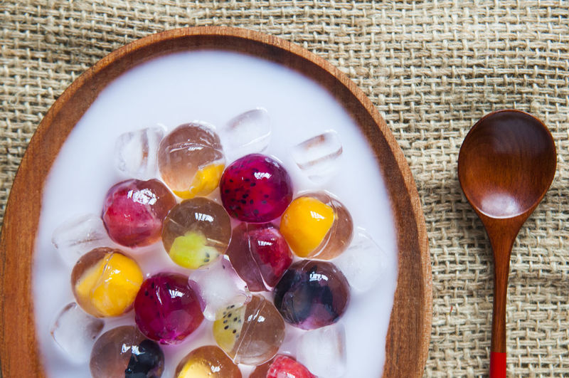 Directly above shot of fruit jelly dessert served in plate on table