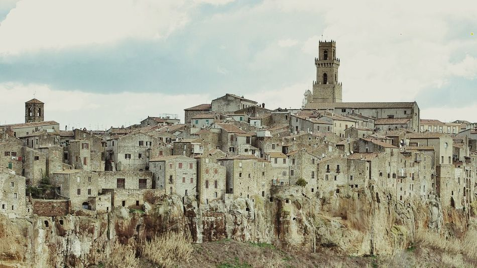 Pitigliano Tuscany Italy Medieval City Medieval Architecture Stone Buildings Bella Italia Treasure UNESCO World Heritage Site Monumental  Cliff Stonework Cityscape Towers Pastel Colors Destination Traveling Travel Photography Tourism Landscapes With WhiteWall