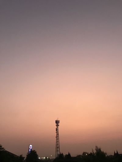 Silhouette tower and buildings against sky during sunset