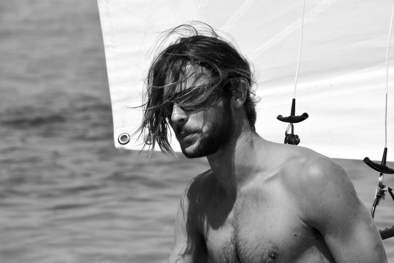 Close-up of shirtless man in water