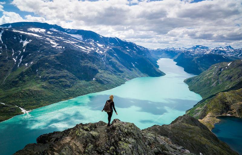 Young woman descending besseggen, jotunheimen, norway.