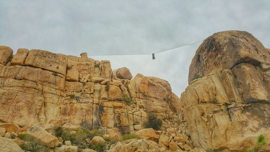 Set up my first Highline today with help from my friends and it was awesome. This is the Little Rock Gap, Joshua Tree National Park California Check This Out That's Me Hanging Out Enjoying Life Nature Photography Eye4photography  Hi! Beautiful Highline Slacklife Slacking First Steps Adrenaline Junkie