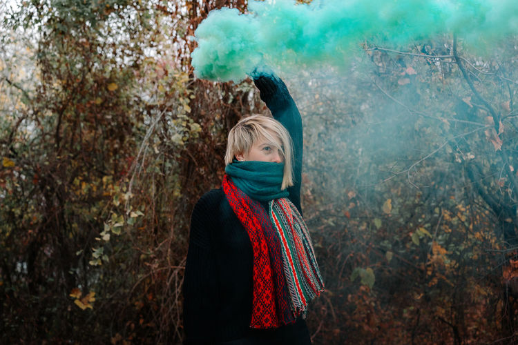 Smoke Smoke - Physical Structure Smoke Bomb Green Color Green One Person One Woman Only Women Young Women Cold Temperature Tree Wearing Fall Leaves Autumn This Is Natural Beauty