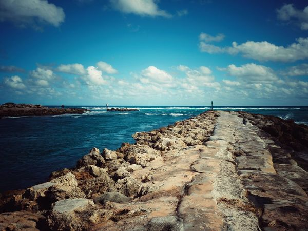 Sea Water Sky Nature Scenics Horizon Over Water Beauty In Nature Jetty Inlet Rock - Object Beach Tranquility Cloud - Sky Day No People Outdoors Pebble Beach Seashore