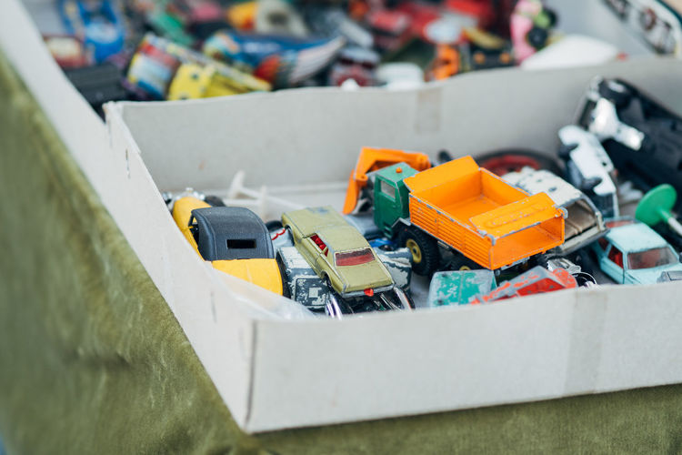 High Angle View Of Weathered Toy Cars In Box