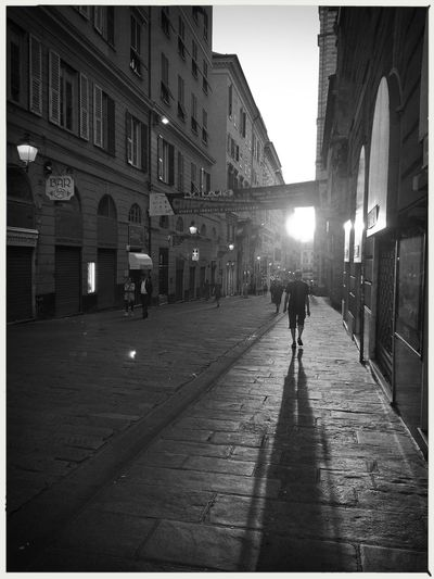 Walking. EyeEm Gallery EyeEmNewHere Architecture Building Exterior Built Structure City Full Length Illuminated Italy Large Group Of People Lifestyles Men Night Outdoors People Popckorn Real People Sky Walking Women The Street Photographer - 2018 EyeEm Awards