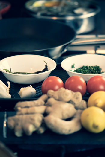 A selection of ingredients and food items at a kitchen - Indian cuisine. Food And Drink Food Freshness Wellbeing Healthy Eating Preparation  Indoors  Selective Focus Close-up Bowl Table Kitchen No People Still Life Kitchen Utensil Domestic Room Preparing Food Vegetable Household Equipment Plate Crockery Snack Tray Indian Cuisine Curry