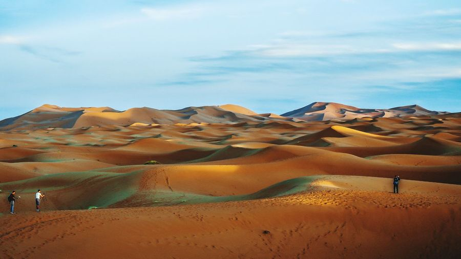 Sahara Sahara Desert Sahara Sunset Desert Sunset Extreme Terrain Desert Outdoors Nature Scenics Travel Destinations Beauty In Nature Real People Adults Only Adult One Person Sand Dune Hiking Arid Climate Vacations Day Sky People Sand