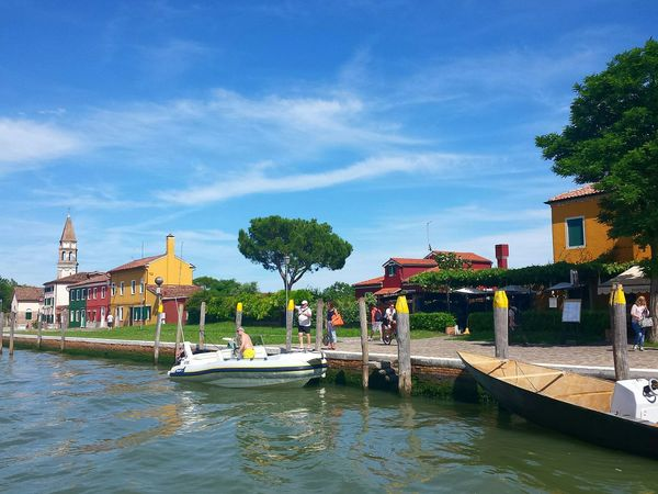 Having visited Murano first, we were now arriving by boat on burano island. Blue Blue Sky Beautiful View Enjoying Life Multi Coloured Bunt Gorgeous Ladyphotographerofthemonth Burano Italy Close To Venice . Perfect Place For Pastel Colors And Blue Sky . Dolce Vita Colourful Colourful Houses Old Houses Houses&Homes Around The World Canals And Waterways Burano, Italy Hugging A Tree Pinie Colour Explosion Colourful Houses Burano, Venice Ancient Beauty Feel The Journey Original Experiences On The Way Coloured Houses Feel The Moment Hugging Trees Holiday Memories Blue Sky White Clouds EyeEm Diversity The Street Photographer - 2017 EyeEm Awards Been There. Lost In The Landscape