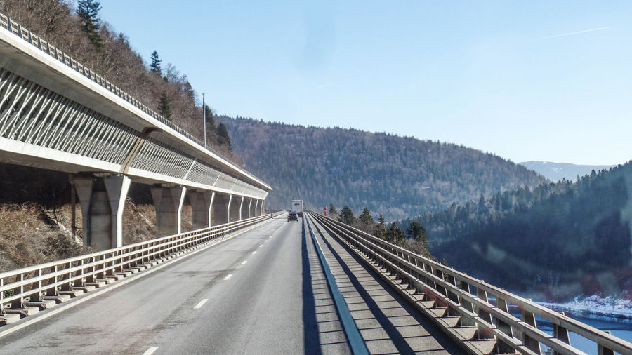 Mountain Transportation Built Structure Sky Architecture Nature Tree Road The Way Forward Day Plant Direction Connection No People Bridge Mountain Range Railing Winter Bridge - Man Made Structure Cold Temperature Diminishing Perspective Outdoors Crash Barrier