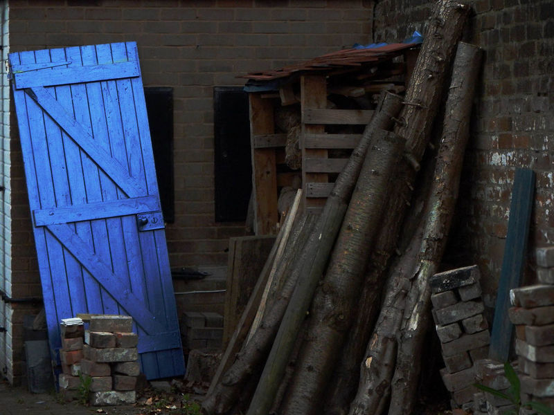 This blue door stood out to me. I was walking around the backstreets of Worcester and noticed it pitched brightly against a darkened background. Blue Door Still Life Photography The Street Photographer - 2018 EyeEm Awards Wood Architecture Blue Built Structure Chopped Wood darkness and light Daylight Still Life Street Street Photography Wood - Material