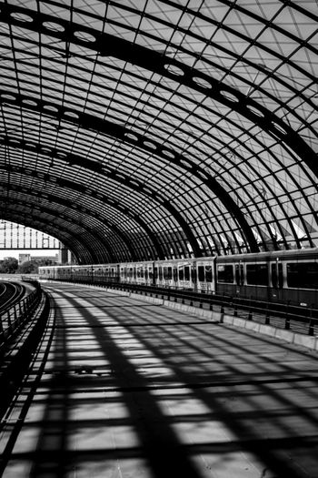 Berlin Haupbahnhof Travel Bnw Blackandwhite Berlin Transportation Rail Transportation Arch Railroad Station Indoors  Public Transportation Railroad Station Platform Railroad Track Day Shadow Built Structure Train - Vehicle No People Architecture Subway Train