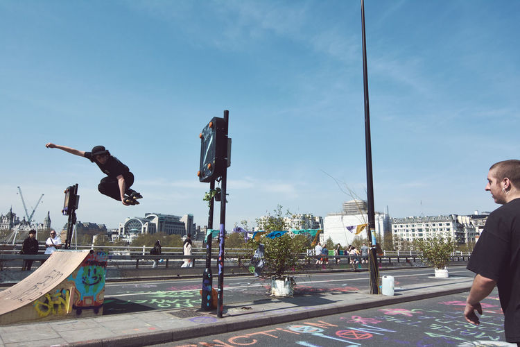 Extinction Rebellion - London 2019 Extinction Rebellion Protest Protesters London Sky Real People Full Length City Leisure Activity One Person Lifestyles Day Men Nature Street Motion Architecture Mid-air Jumping Sport Casual Clothing Transportation Road Skill  Outdoors Exploring Fun
