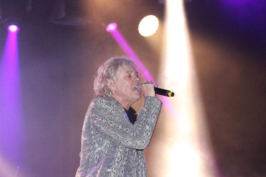 2016 Adult Bob Geldof Boomtownrats Illuminated Indoors  Leisure Activity Lifestyles Microphone Music Musician Night Nightclub One Person People Performance Purple Real People Silverstone Singer  Singing Standing Women