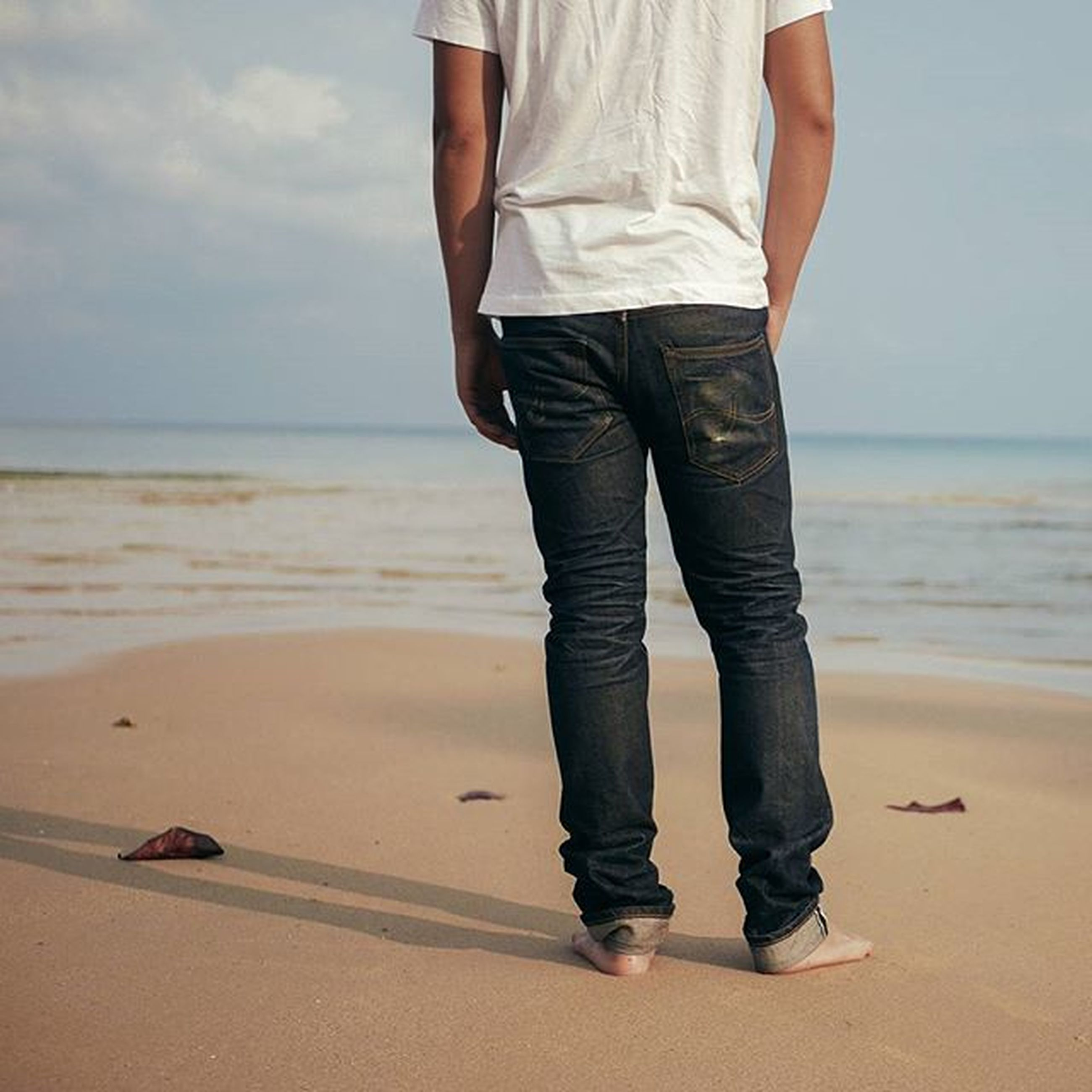 beach, sea, low section, shore, sand, standing, lifestyles, water, person, leisure activity, horizon over water, rear view, sky, men, walking, vacations, casual clothing