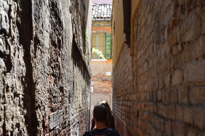 "The narrowest street ""Calletta"" in Venice ... Architecture Building Exterior Built Structure Day Hidden Places Lifestyles Men Narrow Alley Narrow Street One Person Outdoors Rear View Secret Places Venice, Italy EyeEmNewHere"