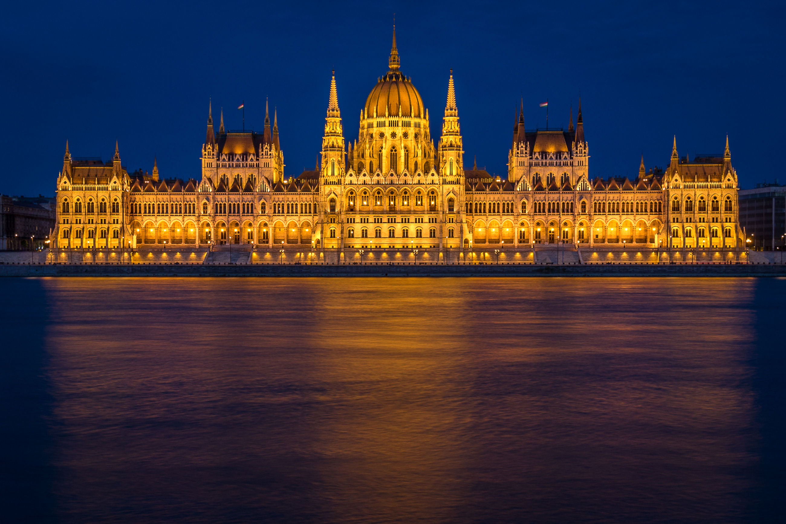 building exterior, built structure, travel destinations, architecture, illuminated, city, water, tourism, travel, river, night, sky, waterfront, government, no people, outdoors