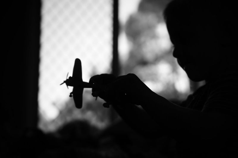 Silhouette child playing with toy