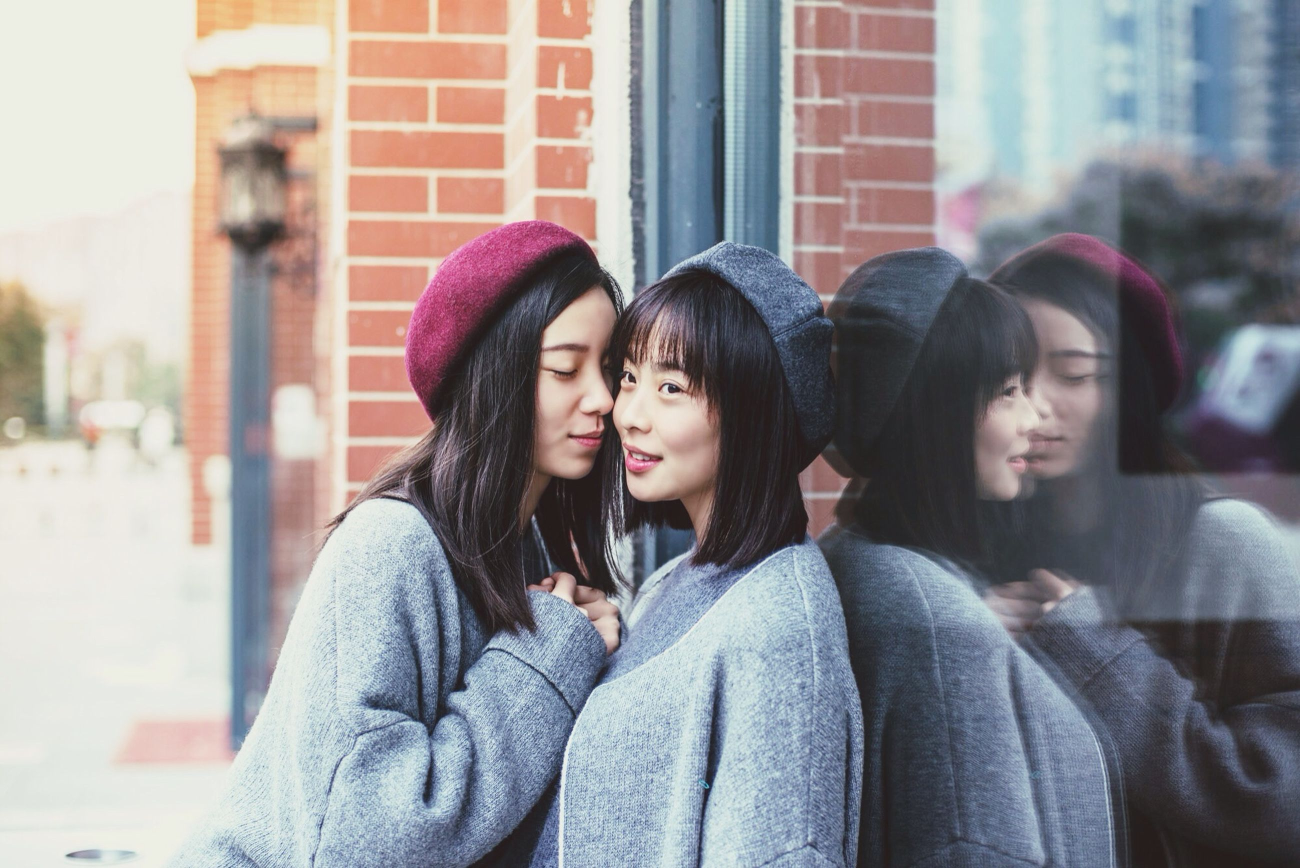 lifestyles, waist up, leisure activity, casual clothing, young adult, person, focus on foreground, headshot, togetherness, warm clothing, front view, bonding, young women, smiling, standing, building exterior