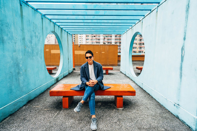 Full Length Of Man Amidst Walls On Seat