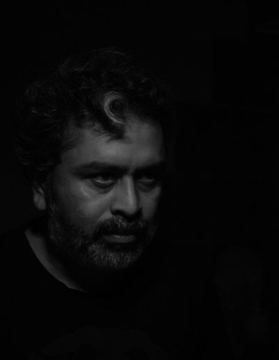 Portrait of a middle aged man in darkness