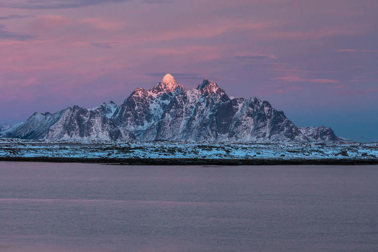 Beauty In Nature Cold Temperature Day Fjord Frozen Lake Lofoten Lofoten Islands Mountain Nature Night No People Norway Outdoors Pastel Red Scenics Sky Snow Sunset Tranquil Scene Tranquility Water Winter The Great Outdoors - 2017 EyeEm Awards