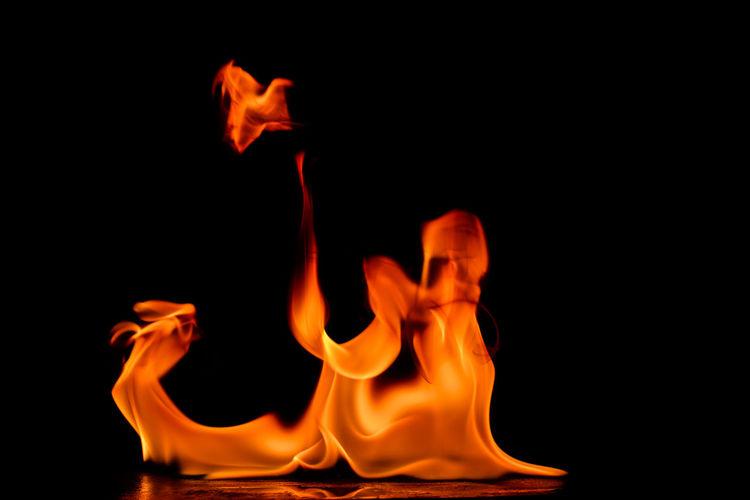Fire flames on a black background Art Beautiful Burn Danger Dark Design Detail Effect Fire Fireplace Flame Heat Hell Hot Nature Night Orange Outdooor Power Reflection Texture Warm Yellow