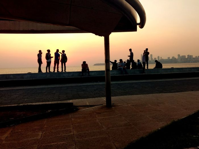 Sunset Vacations Tourism Travel Destinations People Travel Beach Water Outdoors Sky Nature Day Mumbai City WeekOnEyeEm EyeEm Best Shots Check This Out Eyeemphotography Photooftheday Photography Marindrive EyeEm Gallery The Week On EyeEm City Life
