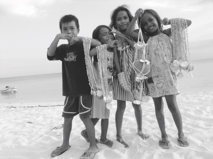 Island children with genuine smiles. 🌴 Beach EyeEmNewHere Happiness Children Islandlife Bantayanislandcebu Sand Portrait Girls And A Boy Looking At Camera Standing Full Length Friendship Outdoors Childhood Togetherness Young Adult People Seashells Living EyeEmNewHere EyeEmNewHere EyeEmNewHere Live For The Story Live For The Story