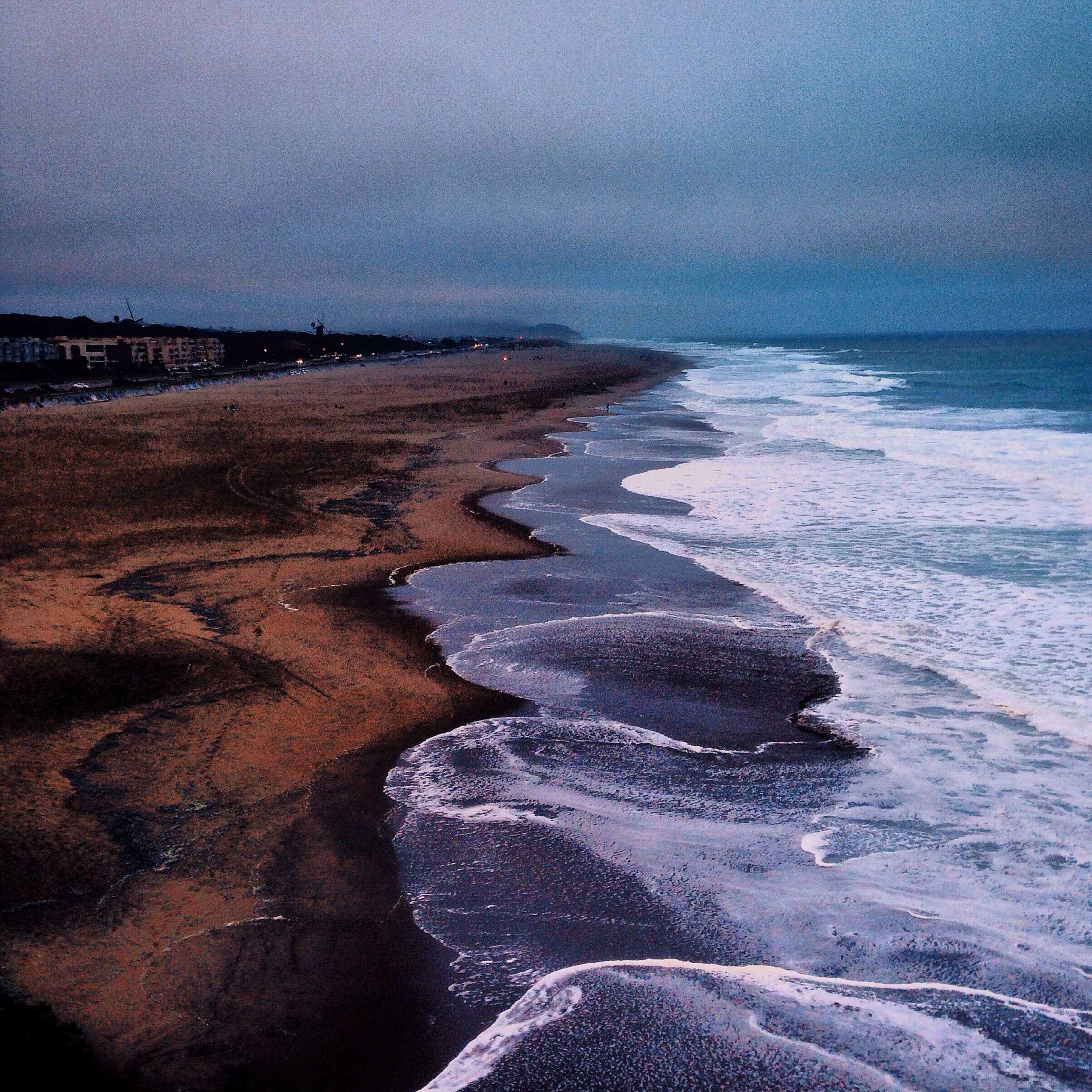 sea, beach, horizon over water, water, tranquil scene, tranquility, scenics, beauty in nature, sky, shore, nature, sand, idyllic, coastline, weather, remote, wave, cold temperature, outdoors, cloud - sky