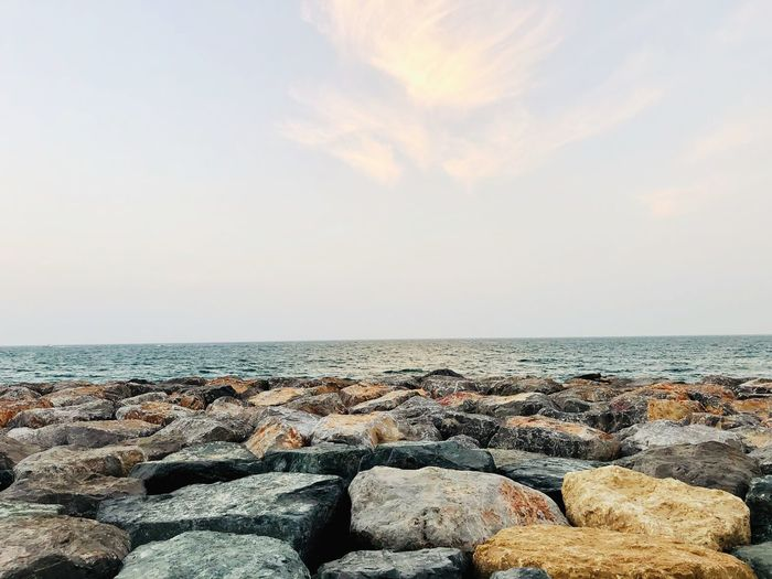 Connects infinity Sea Sky Water Horizon Over Water Horizon Beach Scenics - Nature Beauty In Nature Tranquil Scene Nature Solid Rock Day Land Tranquility Outdoors No People Sunlight Idyllic Rock - Object