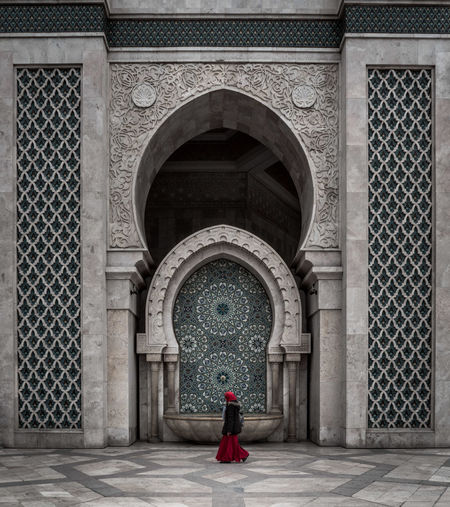 Walk on by EyeEm Best Shots EyeEmNewHere Hassan II Mosque Adult Arch Architectural Column Architecture Building Built Structure Clothing Full Length Leisure Activity Lifestyles One Person Real People Red Street Streetphotography Traditional Clothing Travel Destinations Women The Photojournalist - 2018 EyeEm Awards The Traveler - 2018 EyeEm Awards The Architect - 2018 EyeEm Awards The Street Photographer - 2018 EyeEm Awards