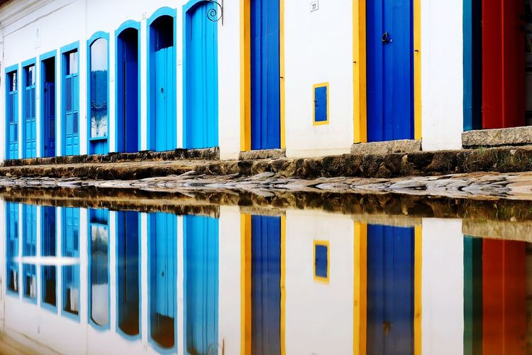 Full Frame Paraty No People Heritage Historical Building Colourful Urban Geometry Building Exterior Urban Geometry Hot Day Cultures Tradition Water Symmetry Multi Colored Window Corrugated Iron Reflection Blue Architecture Built Structure Close-up