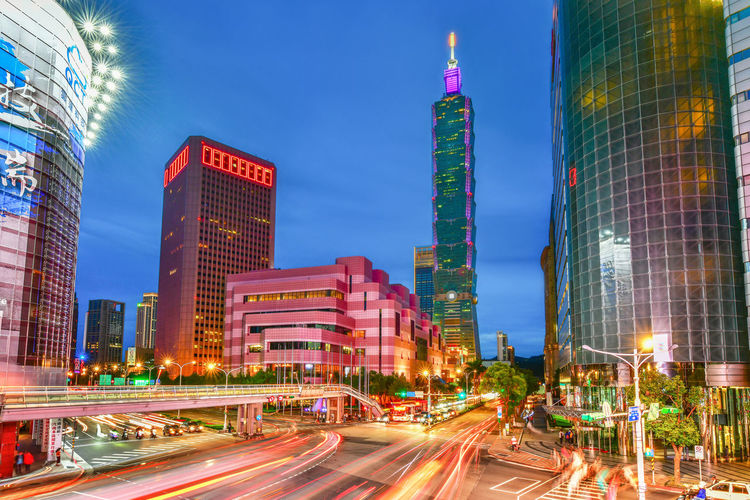Taipei city skyline and downtown buildings with Taipei 101 skyscraper at Twilight time in Taiwan City Architecture Office Building Exterior Motion Skyscraper Long Exposure Built Structure Building Exterior City Life Transportation Light Trail Building Street City Street Road Cityscape Financial District  Modern No People Outdoors Taipei Downtown Taipei 101 Taiwan Taiwan