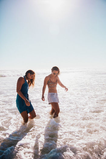 Togetherness Two People Water Sea Fun Beach Sunlight Enjoyment Women Sky Trip Nature Holiday Leisure Activity Vacations Sunny Happiness Summer Freedom Positive Emotion