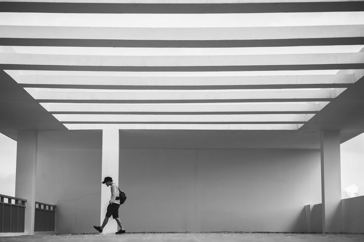 Man walking against wall