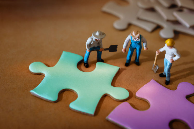 Teamwork, Business Strategy, Connection, Partnership and Team Collaborate Concept. Group of Miniature Worker Working on Jigsaw Puzzle Teamwork Concept Miniature Puzzle  Jigsaw  Partnership Business Group People Team Together Piece Strategy Join Help Solve Work Success Communication Businessman Start Start-up Night Workplace Creativity Idea Fit Meeting Solution Connection Problem Cooperation Unity Part High Desk SUPPORT Figure Sign Closeup Macro Photo Mini Nobody Still Life Figurine  Toy High Angle View Close-up Representation
