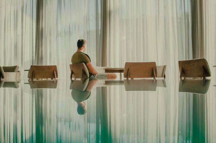 Man sitting on chair in restaurant