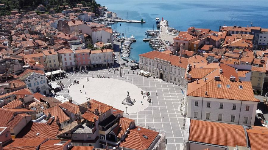 Square Piazza Horizon Over Water Horizon Over Sea Sky Sea Blue Sky Blue Cityscape City Water Sea Aerial View Harbor High Angle View Residential Building Sky Architecture TOWNSCAPE Rooftop Roof Tile Old Town Townhouse Bell Tower Town Boat Human Settlement Residential Structure