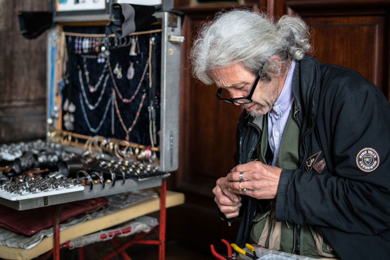 eyeglasses, senior adult, workshop, gray hair, one person, indoors, real people, work tool, gear, technology, one man only, day, adult, adults only, people