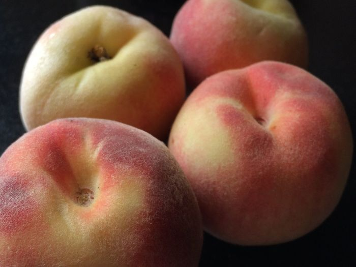 Close-Up Of Peach Against Black Background
