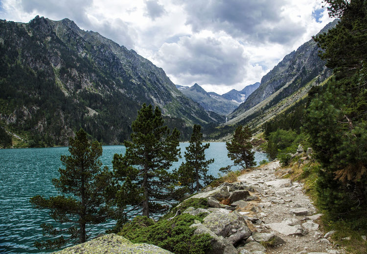 Gaube lake, Central Pyrenees, France Beauty In Nature Cloud Cloud - Sky Countryside Day France Green Hike Lake Landscape Mountain Nature Non-urban Scene Path Pine Pyrenees Rock Scenics Sky Trail Tranquil Scene Travel Valley Walk Water