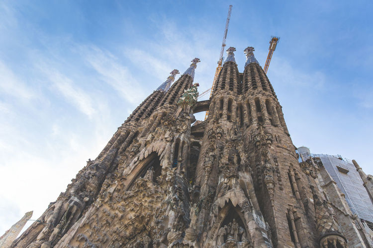Outside Sagrada Familia in Barcelona Architecture Barcelona Blue Sky Built Structure Church Famous Place Gaudi History Religion Sagrada Familia Spirituality Temple - Building Tourism Travel Destinations Vacation
