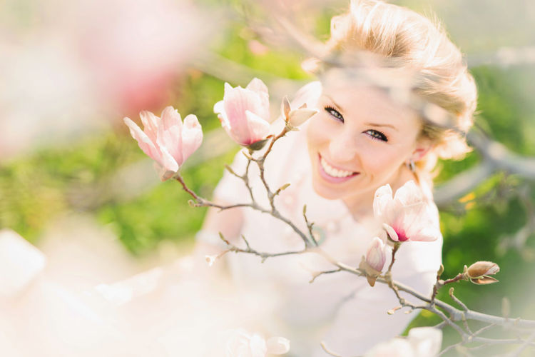 Enjoying a beautiful spring day! Flowering Plant Flower Portrait Plant Looking At Camera Beauty In Nature Young Adult Smiling Freshness Beautiful Woman Beauty Young Women Women Fragility Nature Vulnerability  One Person Pink Color Day Flower Head Outdoors Springtime Hairstyle Magnolia Tree Magnolia Flower