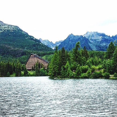 Mountain Scenics Water Lake Mountain Range Nature Beauty In Nature Slovakia Built Structure Architecture Outdoors No People Tree Tranquility Building Exterior Tranquil Scene Travel Destinations Lush Foliage Day Sky Landscape Strbske Pleso